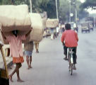 A photo of pedestrians hauling cargo on a Bangalore street.