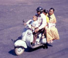 A picture of a family on a motor scooter in Bangalore.